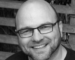 Headshot of Andrew Feinstein