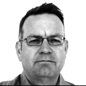 A headshot of Mark Curtis