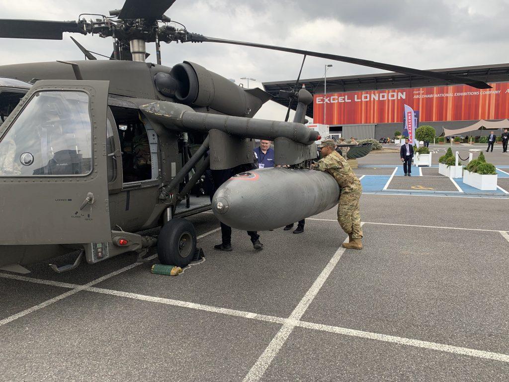 A US soldier leans on a Black Hawk helicopter outside DSEI, 15 September 2021. (Photo: Matt Kennard / Declassified UK)