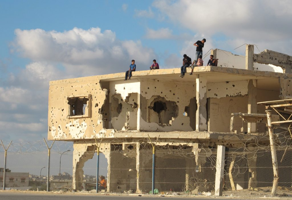 Children play atop a bullet-riddled building in Gaza, 2011 (Photo: Shareef Sarhan / UN)