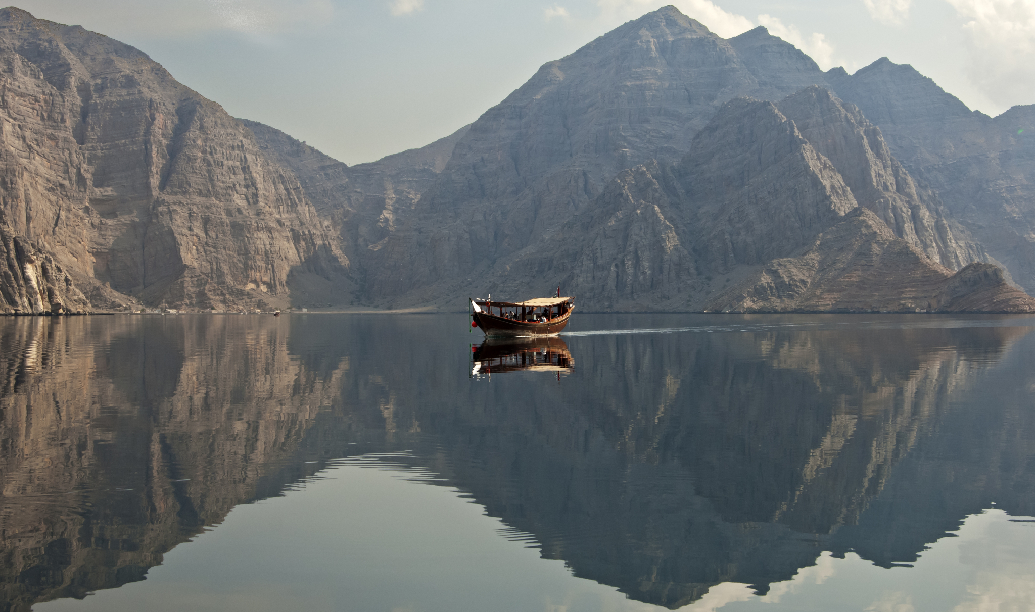 A dhow passes the Musandam peninsula (Photo: Gunter Fischer / Getty)